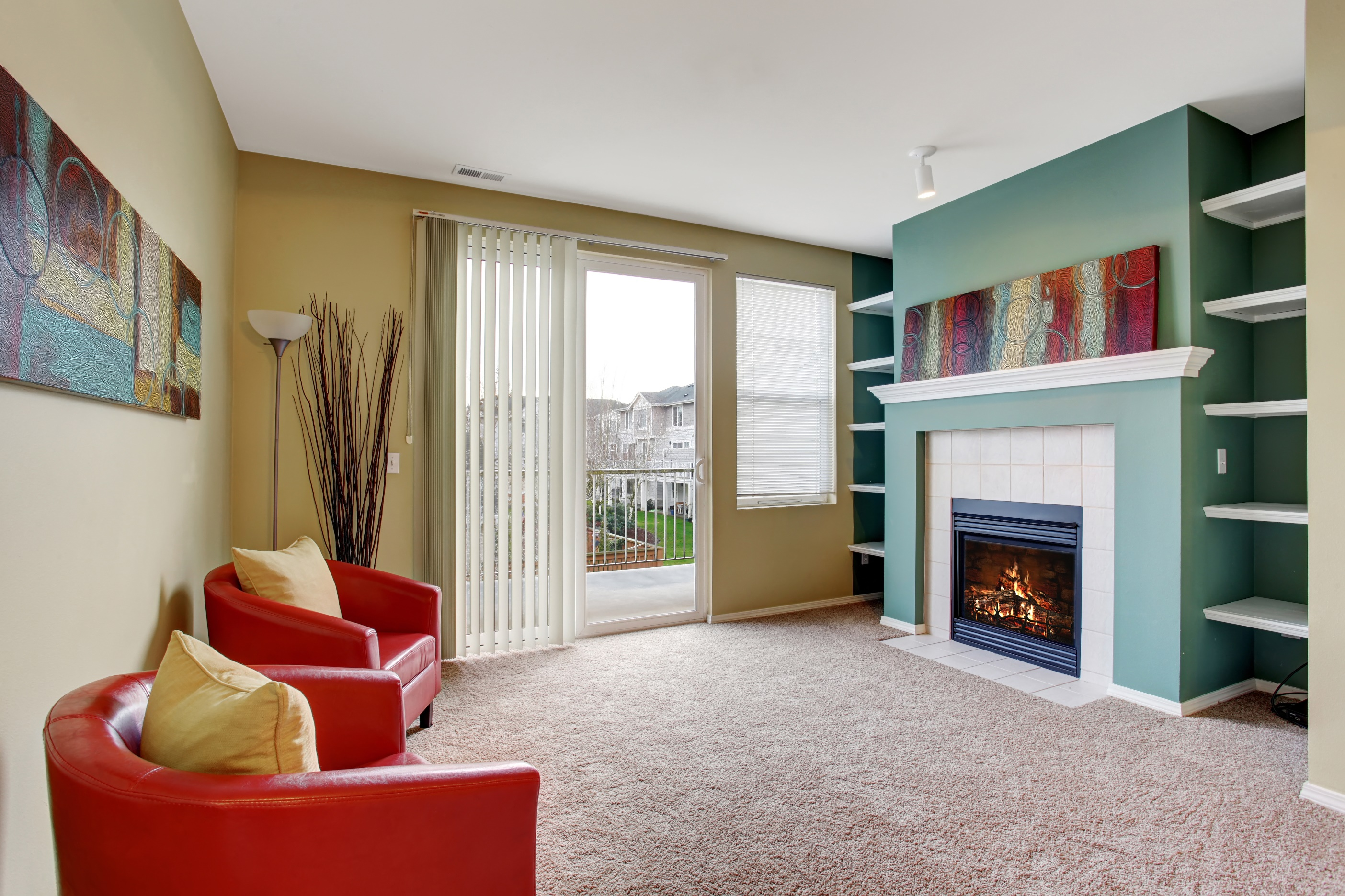 Nice living room with carpet, and fireplace.