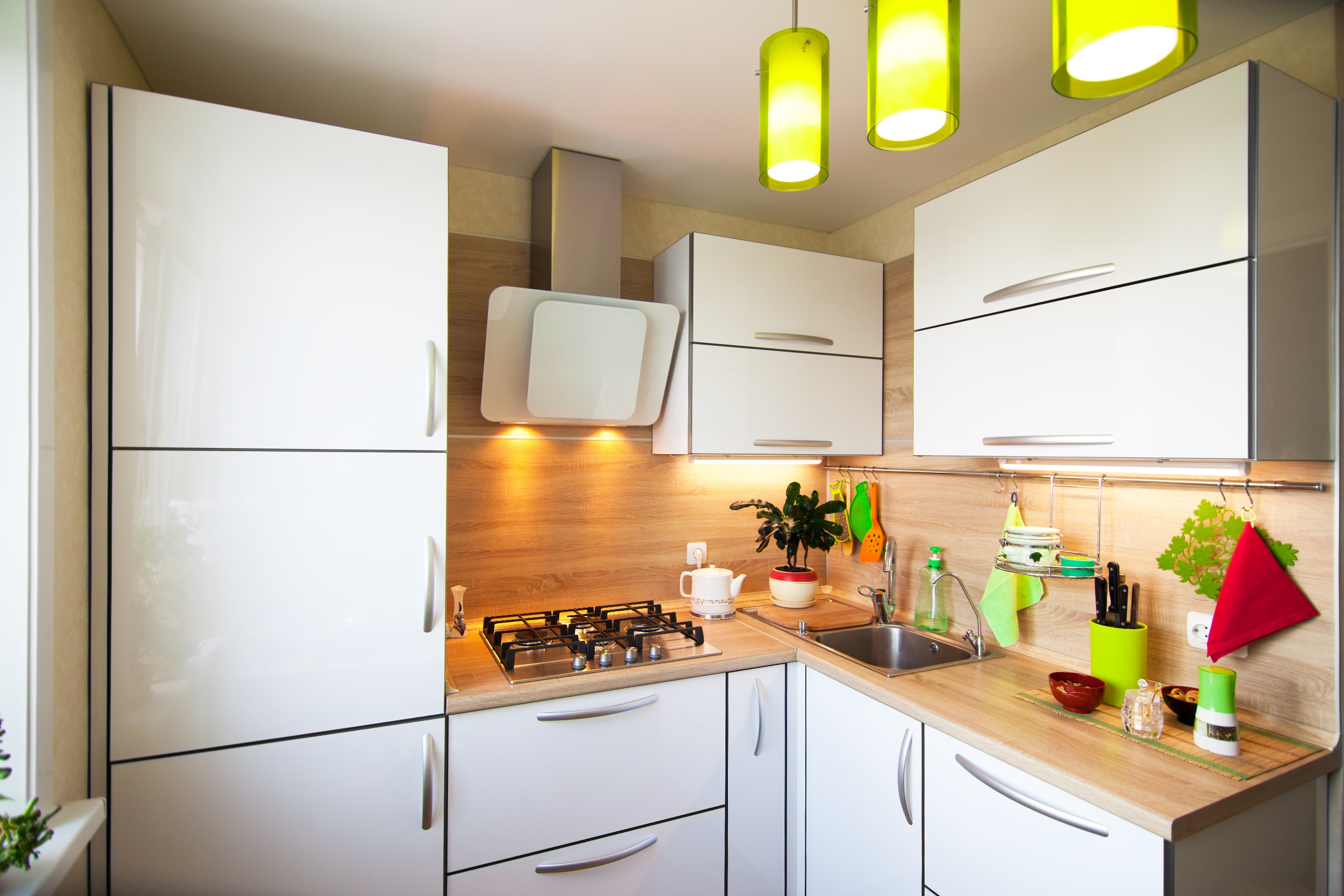 White and brown interior for small kitchen with green elements