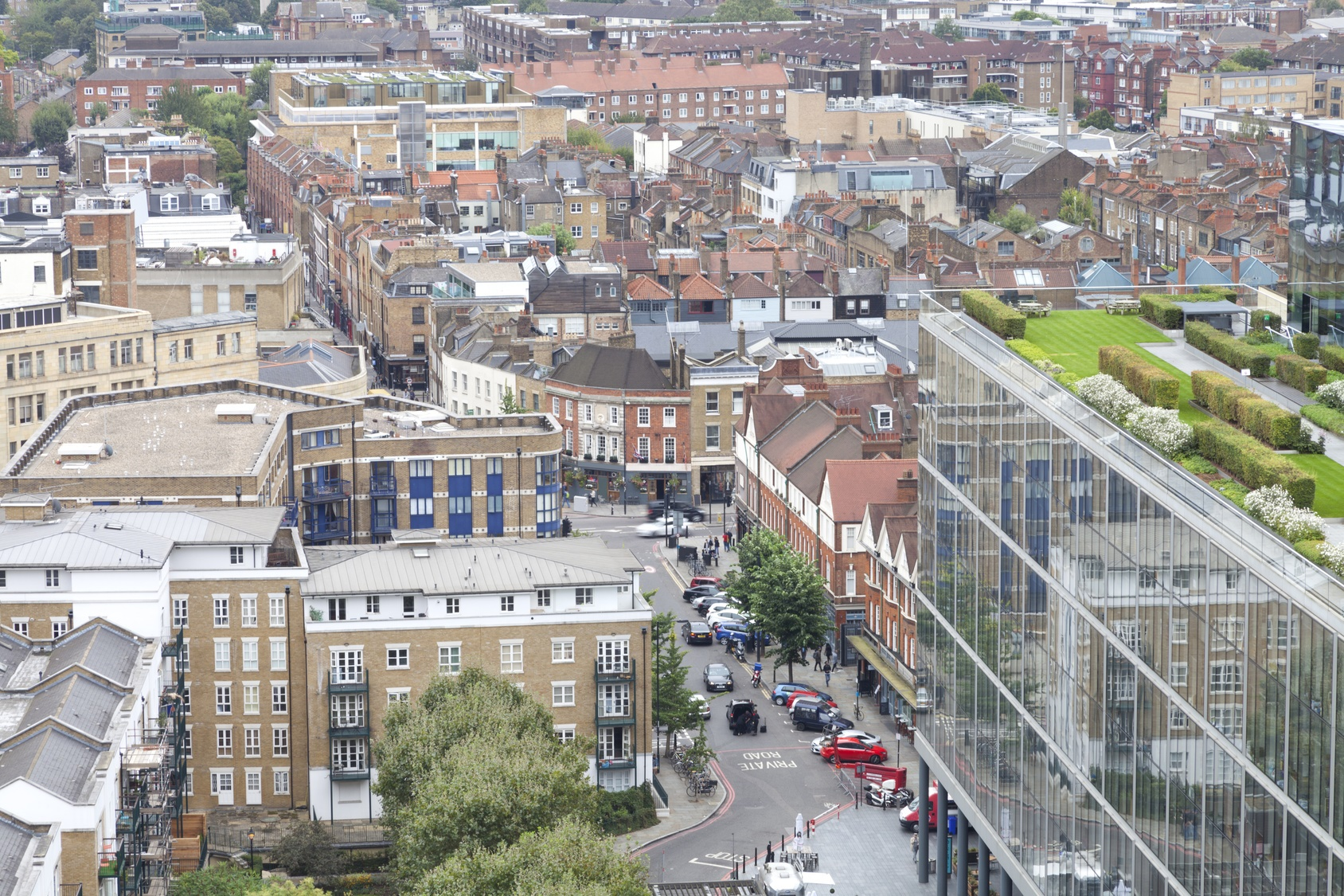 Aerial view of east London busy urban district with densely built up houses, shops, offices