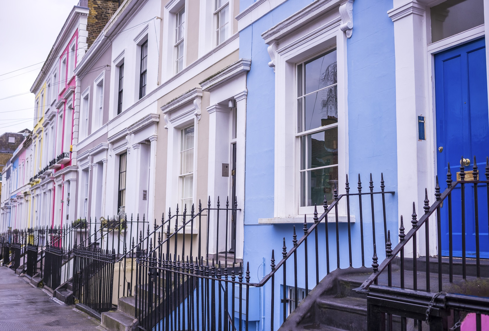 Traditional colourful houses at Notting Hill district near Portobello road - London, UK