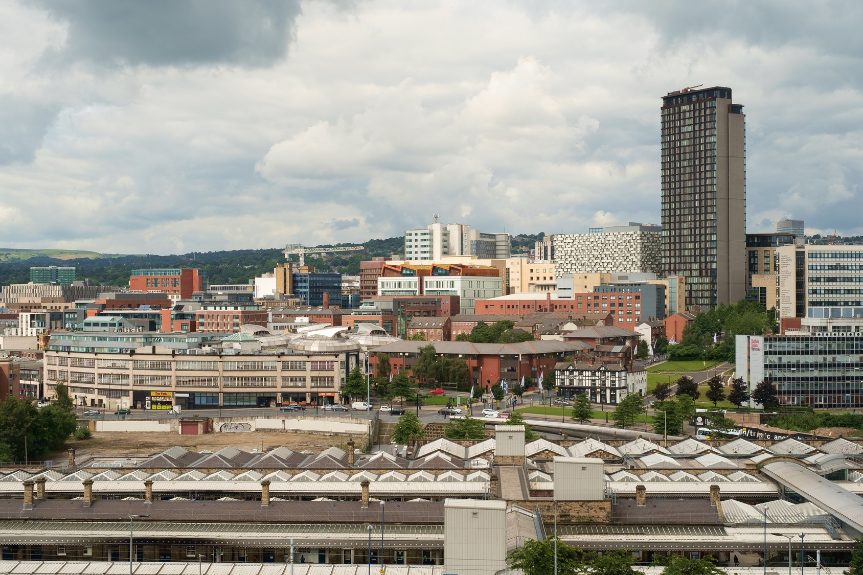 Cityscape of Sheffield with train station in foreground