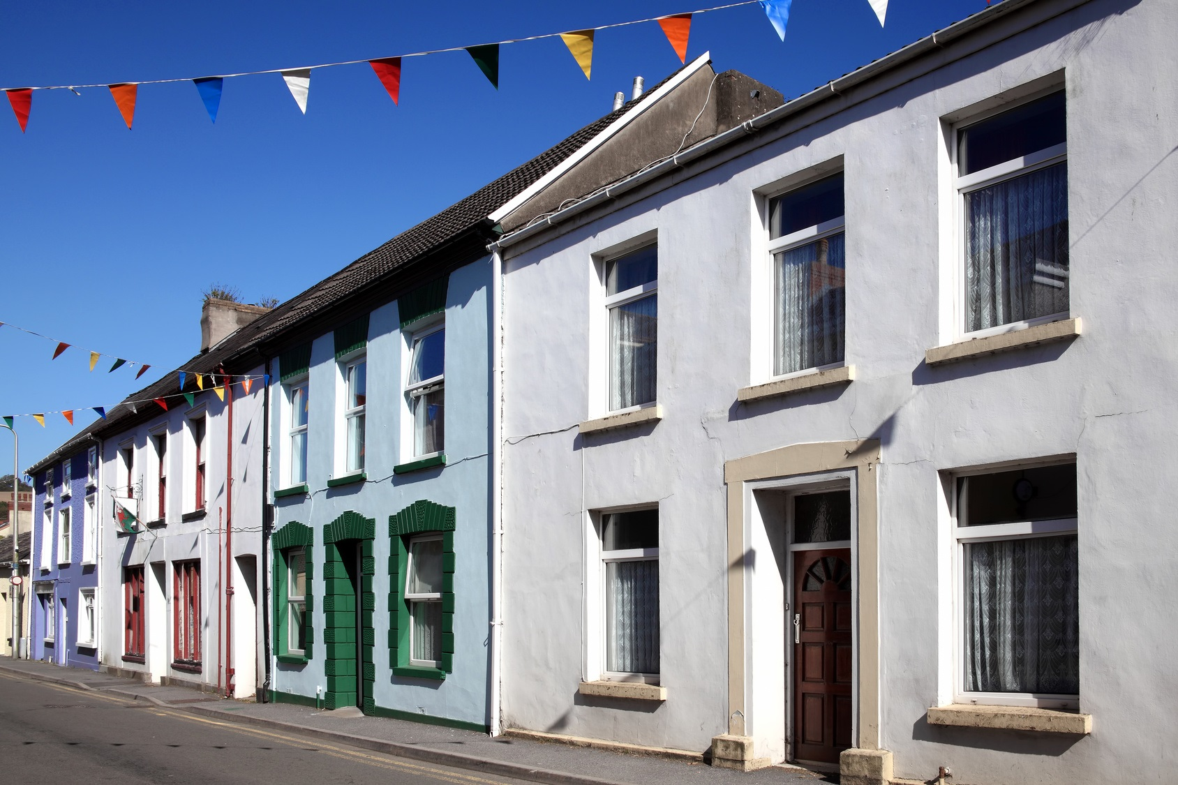 Old fashioned colourful terraced town houses in Kidwelly, Carmarthenshire, Wales, UK